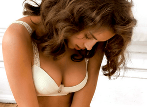 Почему болит грудь после месячных?